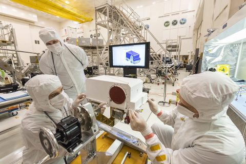 In this picture - taken on May 23, 2019, in the Spacecraft Assembly Facility's High Bay 1 clean room at the Jet Propulsion Laboratory in Pasadena, California - engineers re-install the cover to the remote sensing mast (RSM) head after integration of two Mastcam-Z high-definition cameras that will go on the Mars 2020 rover. (NASA/JPL-Caltech)