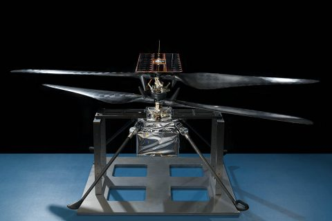 This image of the flight model of NASA's Mars Helicopter was taken on Feb. 14, 2019, in a cleanroom at NASA's Jet Propulsion Laboratory in Pasadena, California. The aluminum base plate, side posts, and crossbeam around the helicopter protect the helicopter's landing legs and the attachment points that will hold it to the belly of the Mars 2020 rover. (NASA/JPL-Caltech)