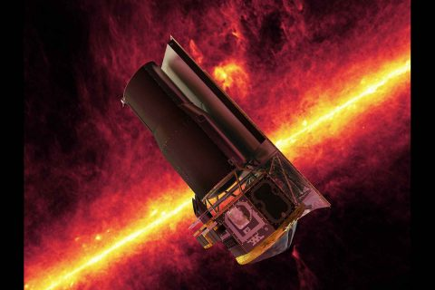 This artist's concept shows NASA's Spitzer Space Telescope in front of an infrared image of the Milky Way galaxy. (NASA/JPL-Caltech)