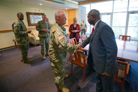 Lt. Col. John Rigdon, commander for the Recruiting and Retention Battalion of the Tennessee Army National Guard, greets retired Lt. Gen. Ronald Bailey, vice president for External Affairs at Austin Peay State University. (APSU)