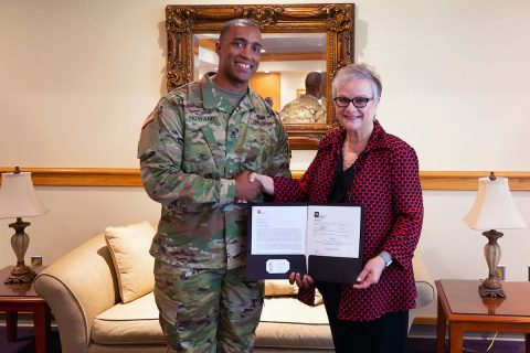 Staff Sgt. Michael Howard, APSU military science instructor and Army National Guard recruiter, and Austin Peay State University President Dr. Alisa White hold the Tennessee STRONG Act deferment agreement. (APSU)