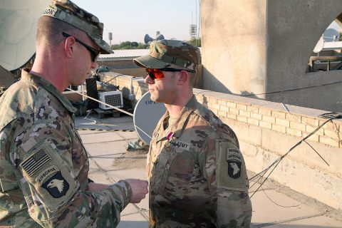 U.S. Army Col. Derek Thomson, deputy commander of Task Force Iraq and 1st Brigade Combat Team, 101st Airborne Division commander, presents U.S. Army Maj. Dana Lafarier, Task Force Iraq and 1st Brigade Combat Team, 101st Airborne Division fire support officer, with the Meritorious Service Medal for his contributions to the unit on June 30, 2019 in Baghdad. (Maj. Vonnie Wright, 1st Brigade Combat Team, 101st Airborne Division (AA) Public Affairs)