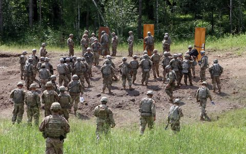 Iowa National Guard and 101st Airborne Division engineer Soldiers prepare to conduct a live urban breach during an eXportable Combat Training Capability rotation at Camp Ripley, Minn., on July 15, 2019. The National Guard and active duty units had the opportunity to train together as part of their working relationship. (Sgt. Tawny Schmit)
