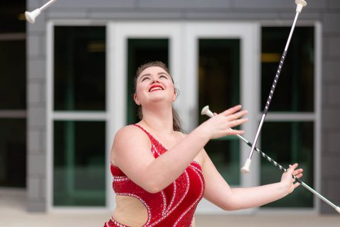 Austin Peay feature twirler Izzy Melbin with three batons. (APSU)