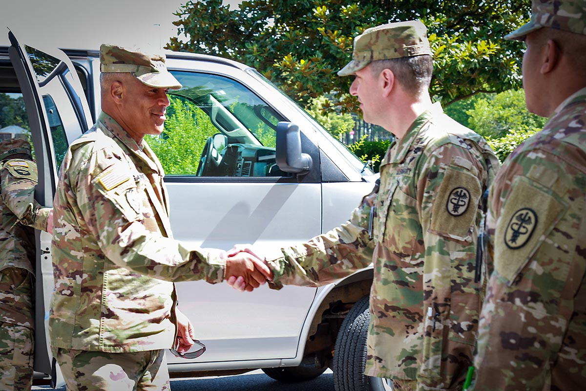 Col. Patrick T. Birchfield, center, Blanchfield Army Community Hospital commander, and Command Sgt. Maj. Christopher Earle, right, welcome Gen. Michael X. Garrett, U.S. Army Forces Command commander, to the hospital, June 25. (U.S. Army photo by David Gillespie)