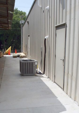 The Grounds and Facilities Maintenance project included upgrading the HVAC system and pouring new concrete between new and old buildings at the workplace.