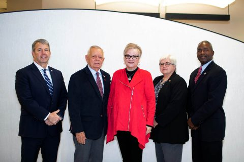 APSU President Alisa White (center) stands with Scott Brower, Gary Luck, Robin Mealer and Ronald Bailey, four retired generals now working for Austin Peay State University.