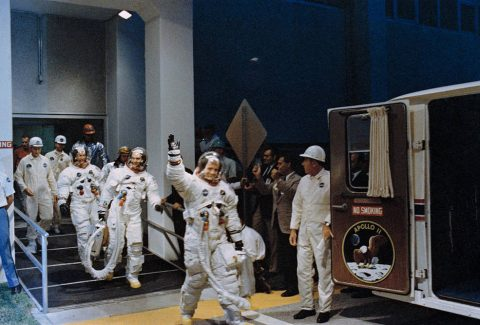 Apollo 11 astronauts (left to right) Aldrin, Collins, and Armstrong leaving crew quarters to enter the Astrovan for the ride to Launch Pad 39A.