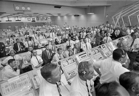 Engineers in KSC's Firing Room watch the launch after Apollo 11 cleared the launch tower.