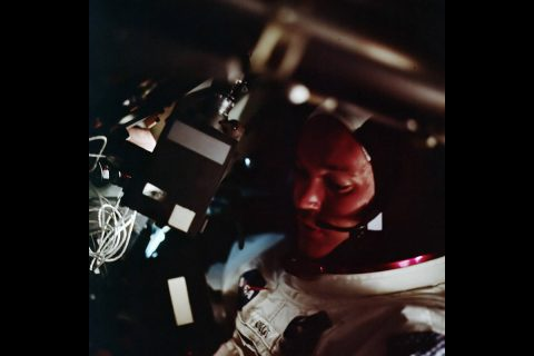 Collins inside the CM during its first orbit around the Earth.