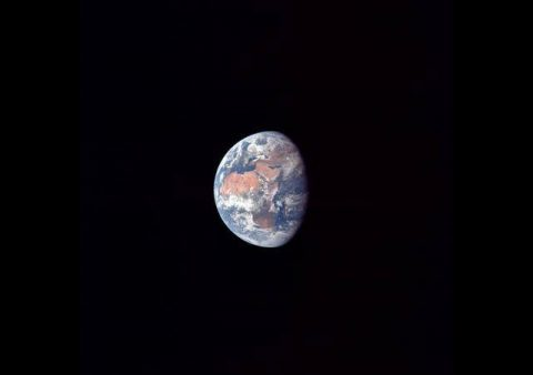 Photograph taken from Apollo 11 showing the receding Earth shortly after the transposition from 113,000 miles.