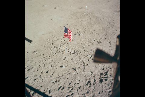 From Aldrin's window, showing the flag and the TV camera. (NASA)