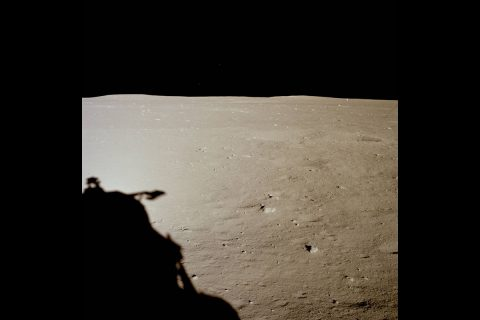 View of the lunar surface as Armstrong and Aldrin saw it shortly after landing, taken through Aldrin's right side window. (NASA)