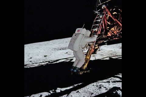 Image of Aldrin climbing down Eagle's ladder to join Armstrong on the surface. (NASA)