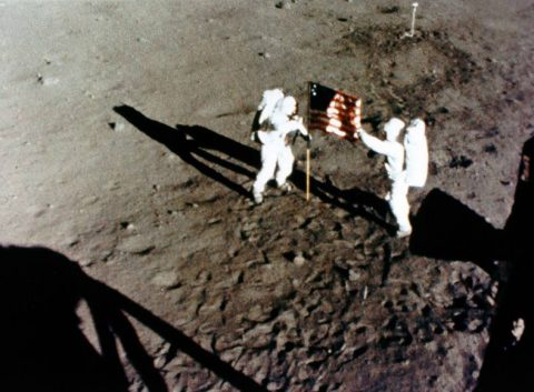 Still from 16-mm film of Armstrong (left) and Aldrin setting up the American flag. (NASA)