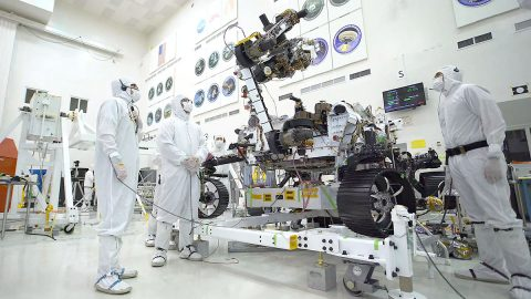 In this image, taken July 19, 2019, in the clean room of the Spacecraft Assembly Facility at JPL, the rover's 7-foot-long (2.1-meter-long) arm maneuvers its 88-pound (40-kilogram) sensor-laden turret as it moves from a deployed to a stowed configuration. (NASA/JPL-Caltech)