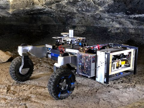 The CaveR rover preparing to search for life on the walls of a lava tube in Lava Beds National Monument in northeastern California. The rover's instrumentation can be seen in the box on its right side. (NASA)