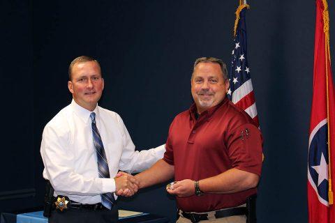 Montgomery County Sheriff John Fuson congratulates Lieutenant Steve Heise.