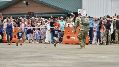 Family and friends happily greet members of the Tennessee Guard's 1-230th Assault Helicopter Battalion who returned from an 11-month overseas deployment to Kosovo on July 17, 2019 at the Volunteer Training Site in Smyrna.  (Army Sgt. Robert Mercado)