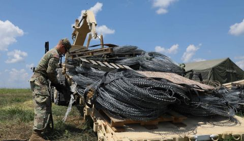 A Soldier of the 101st Sustainment Brigade, 101st Airborne Division (Air Assault), secures concertina wire and other supplies to a military vehicle for transportation during field exercise Eagle Talon II, on Fort Campbell, August 5, 2019. Lifeliners' Soldiers are training in the field, participating in Eagle Talon II, a 10-day division-wide exercise, from August 5th to the 16th, designed to prepare Soldiers and leadership for the larger warfighter exercise, which will validate their warfighting skills as a complete fighting force. (Sgt. Aimee Nordin, 101st Sustainment Brigade Public Affairs)