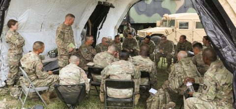 Lt. Col. R. Arron Lummer (center), commander of the 101st Special Troops Battalion, 101st Sustainment Brigade, conducts a battle update brief with his senior leadership in order to see how battalion sustainment field operations are going, August 6, 2019, on Fort Campbell, Kentucky. Lifeliners' Soldiers are training in the field, participating in Eagle Talon II, a 10-day division-wide exercise, from August 5th to the 16th, designed to prepare Soldiers and leadership for the larger warfighter exercise, which will validate their warfighting skills as a complete fighting force. (Sgt. Aimee Nordin, 101st Sustainment Brigade Public Affairs)