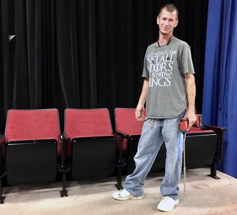 N&J Flooring's Jeremy Tipton discovered the playbill and tickets when a row of old Trahern Theatre seats toppled on top of him. (APSU)