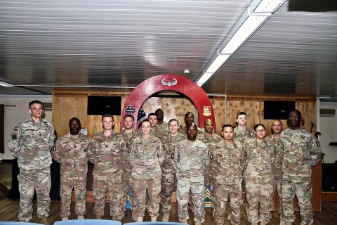 Newly inducted U.S. Army Non-Commissioned Officers serving in the 426th Brigade Support Battalion, 1st Brigade Combat Team, 101st Airborne Division stand with Command Sgt. Maj. Charles W. Albertson at their NCO Induction Ceremony on July 23, 2019 at Camp Taji, Iraq. (Maj. Vonnie L. Wright)