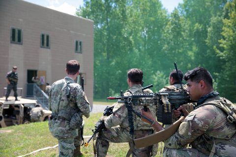 Soldiers of C Troop, 1st Squadron, 75th Cavalry Regiment, 2nd Brigade Combat Team, 101st Airborne Division, conduct a blank-fire raid on a building in the Fort Campbell training area on Wednesday, August 14, 2019. The soldiers spent two weeks training with Green Berets from 5th Special Forces Group (Airborne), on various battle drills, mission planning and casualty care. (U.S. Army photo by Staff Sgt. William Howard)