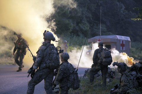 """Green Berets from 5th Special Forces Group (Airborne), signal for an evacuation with soldiers of C Troop, 1st Squadron, 75th Cavalry Regiment, 2nd Brigade Combat Team, 101st Airborne Division, during the culminating event of a two-week exercise in the Fort Campbell training area on Friday, August 16, 2019. """"Our goal was to do a week of SOP development, do small unit tactics and then take them through a planning process into operation,"""" said a Green Beret with 5th SFG(A). (U.S. Army photo by Staff Sgt. William Howard)"""