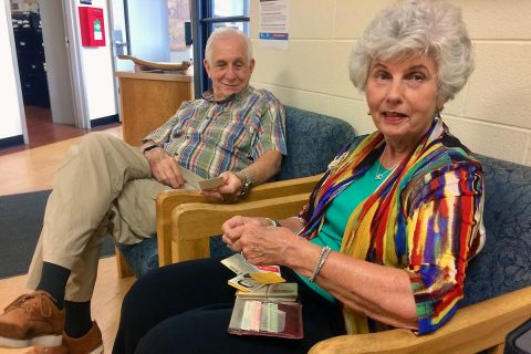 Drs. Harriet and Leon McQueen look through the billfold's contents, untouched for nearly 32 years. (APSU)