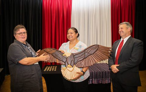 Dr. Beatrix Brockman presents an eagle she crafted to Jasmin Linares and retired Brig. Gen. Scott Brower. (APSU)