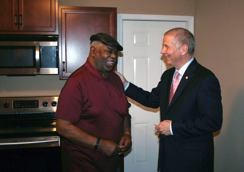 Clarksville Mayor Joe Pitts presents Marion Watkins Jr. with the keys to his rebuilt home on Cedar Street. HOME, a federal housing program, provided a low-cost guaranteed loan to Watkins, and the City of Clarksville provided a 25 percent match and managed the project.