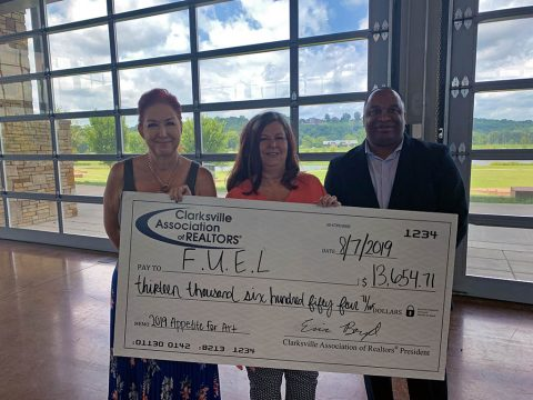 Clarksville Association of Realtors presents F.U.E.L. with a check for $13,541.71