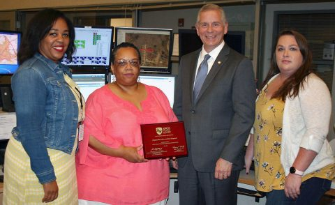 Clarksville Mayor Joe Pitts congratulates members of the Clarksville Police & Fire Dispatch team who helped the department earn Association of Public Safety Communications Officials Certification. Team members, from left, are Angee Daniel, Marla Bonner, and Chaning Jewett.