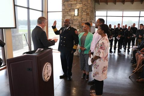 Clarksville Mayor Joe Pitts issues the oath of office to Freddie D. Montgomery Jr., Clarksville Fire Rescue's 17th Fire Chief, during the swearing in ceremony Thursday at Freedom Point. (Samantha Stoffregen)