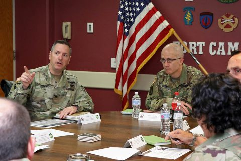 From left, Col. Patrick T. Birchfield, Blanchfield Army Community Hospital commander briefs Maj. Gen. Ron Place, Defense Health Agency acting director for health care administration Aug. 7. Place visited Blanchfield and Fort Campbell for further discussions on the hospital's transition from Army Medicine to DHA, Oct. 1. (U.S. Army, Maria Yager)