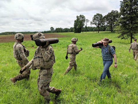 Soldiers from the 101st and Dr. Matthew Yandell, chief innovation officer of HeroWear and recent Vanderbilt graduate, carry howitzer rounds to simulate the physical demands of field artillery missions. (Dr. Karl Zelik, Vanderbilt University)