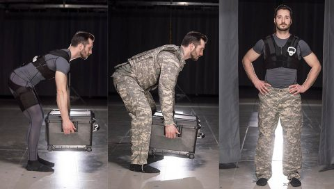 Erik Lamers, of Vanderbilt's CREATe Lab, demonstrates the use of a spring-powered exosuit with existing Army gear. Working with members of 3rd BCT, researchers from Vanderbilt developed the suit and other biomechanically assistive tools to reduce injury and lighten Soldiers' loads. (Joe Howell, Vanderbilt University)