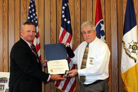Montgomery County Mayor Jim Durrett congratulates Lieutenant Cliff Smith from the Montgomery County Sheriff's Office.