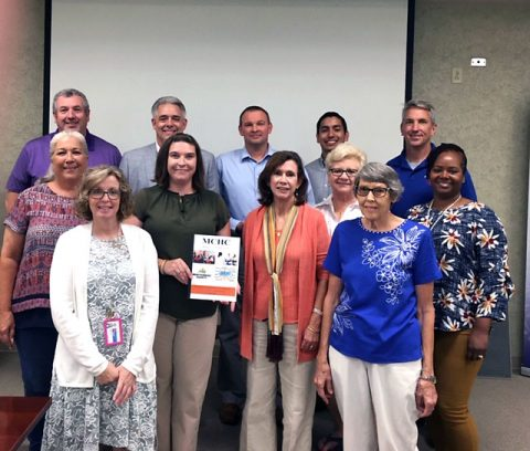 MCHC Monthly Meeting: Members and guest, Candis Batey, display the Montgomery County Mental Health Directory. (Back Row L to R) Tim Swaw, Jay Albertia, Joey Smith, Isaiah Hurtado and Rich Holladay. (Middle Row L to R) Candis Batey, Carlye Sommers, Dr. Patty Orr, Loretta Bryant and Tanya Johnson. (Front Row L to R) Patti Hill and Bertha Drew.