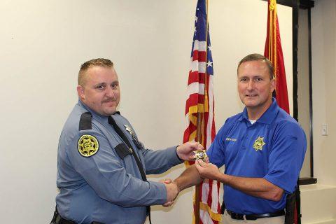 Montgomery County Sheriff Sheriff John Fuson congratulates Bruce Hartley.