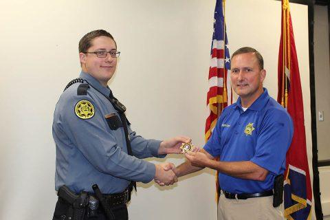 Montgomery County Sheriff Sheriff John Fuson congratulates David Corder.