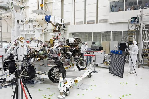 In this image, engineers test cameras on the top of the Mars 2020 rover's mast and front chassis. The image was taken on July 23, 2019, in the Spacecraft Assembly Facility's High Bay 1 at NASA's Jet Propulsion Laboratory in Pasadena, California. (NASA/JPL-Caltech)