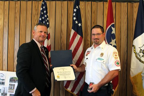 Montgomery County Mayor Jim Durrett congratulates District Assistant Chief Shaun Arms from the Montgomery County Volunteer Fire Service.