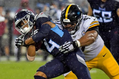 Tennessee Titans wide receiver Kalif Raymond (14) is tackled by Pittsburgh Steelers defensive end Cameron Heyward (97) during the first half at Nissan Stadium. (Jim Brown-USA TODAY Sports)
