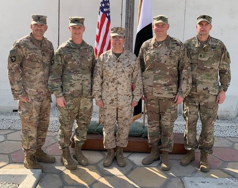 From left, U.S. Army Command Sgt. Maj. Wray Gabelmann, Command Sgt. Maj. of 1st Brigade Combat Team, 101st Airborne Division, U.S. Army Col. Derek Thomson, Commander of 1st Brigade Combat Team, 101st Airborne Division, U.S. Marine Corps Brig. Gen. William Seely, commander of Task Force Iraq, Col. Matthew Brown, Commander of 1st Stryker Brigade Combat Team, 25th Infantry Division, and Command Sgt. Maj. Matthew Ladd, Command Sgt. Maj. of 1st Stryker Brigade Combat Team, 25th Infantry Division, stand together after the colors casing and uncasing ceremony. (Maj. Vonnie Wright 1st Brigade Combat Team, 101st Airborne Division (AA) Public Affairs)