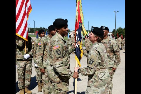 Col. Stephanie Barton (right) passes the brigade colors to the new Command Sgt. Maj. Kevin Campbell during a Change of Responsibility Ceremony Aug. 29, 2019, on Fort Campbell, Kentucky. Soldiers, assigned to 101st Sust. Bde., 101st Airborne Division (Air Assault), bid farewell to Command Sgt. Maj. Anthony McAdoo and his family as well. (Sgt. Aimee Nordin, 101st Sustainment Brigade Public Affairs)
