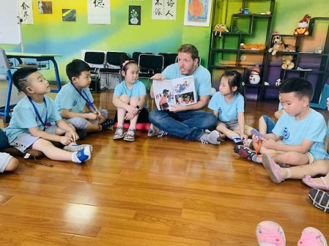 Gavin Brant reads to a class in China. (APSU)