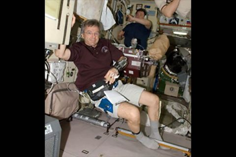 "Former Canadian Astronaut Robert ""Bob"" Thirsk wearing device which continuously measures blood pressure. (NASA)"