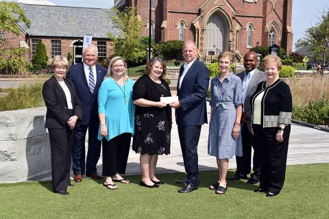 (L-R) Jill Crow (Loaves & Fishes Capital Campaign Chair), Charles D. Keene, Tamara Long (Loaves & Fishes President), Dr. Rita Burnett (Loaves & Fishes Executive Director), Scott Giles (FPC Finance Committee Chair), Vicki Wallace, Issac Wright (Loaves & Fishes Construction Project Manager), and Joyce Norris (FPC Bicentennial Campaign Chair). Scott Giles presents a check for $150,000 to Dr. Rita Burnett. (Gary Norris)